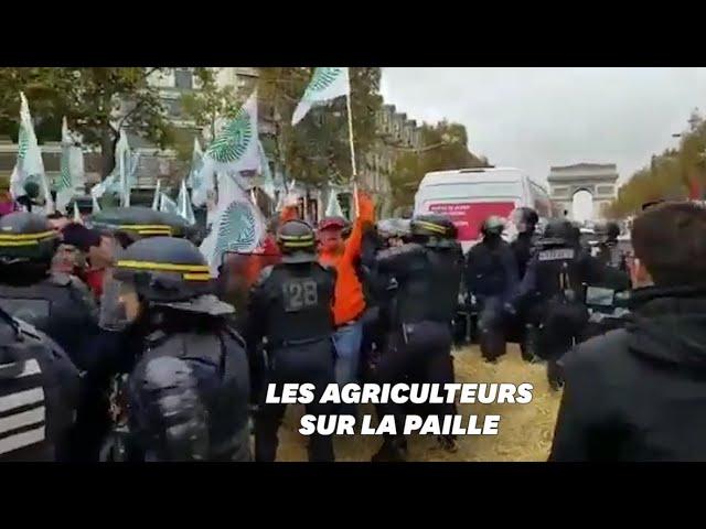 Les agriculteurs bloquent les Champs-Élysées et veulent rencontrer Macron