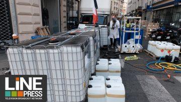 COVID-19. Une pharmacie prépare dans la rue des gels hydroalcooliques / Paris